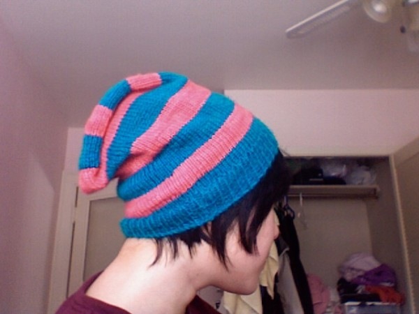 a stripy pink and turquoise hat