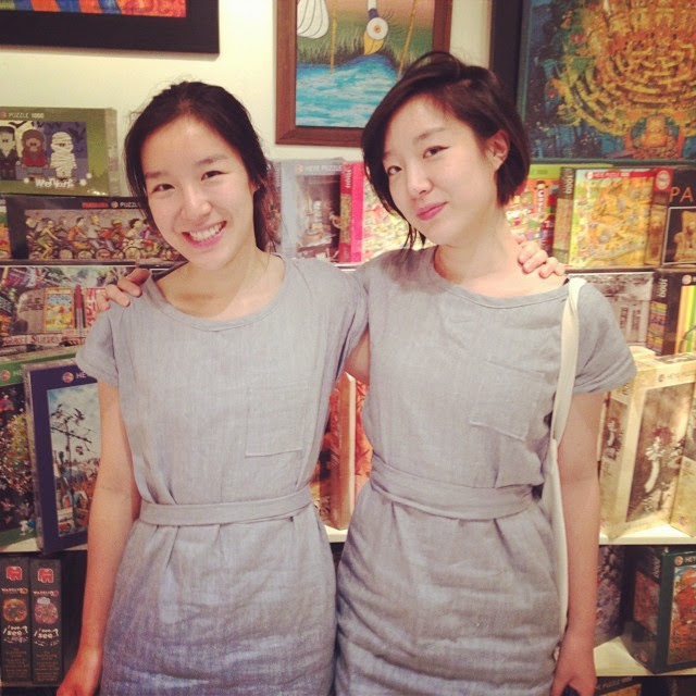 asian twins wearing matching dresses