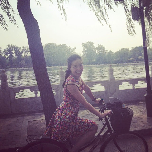 circle skirt dress on a bicycle