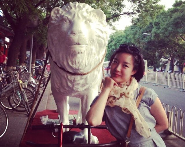 lion hitched to bicycle with pretty girl