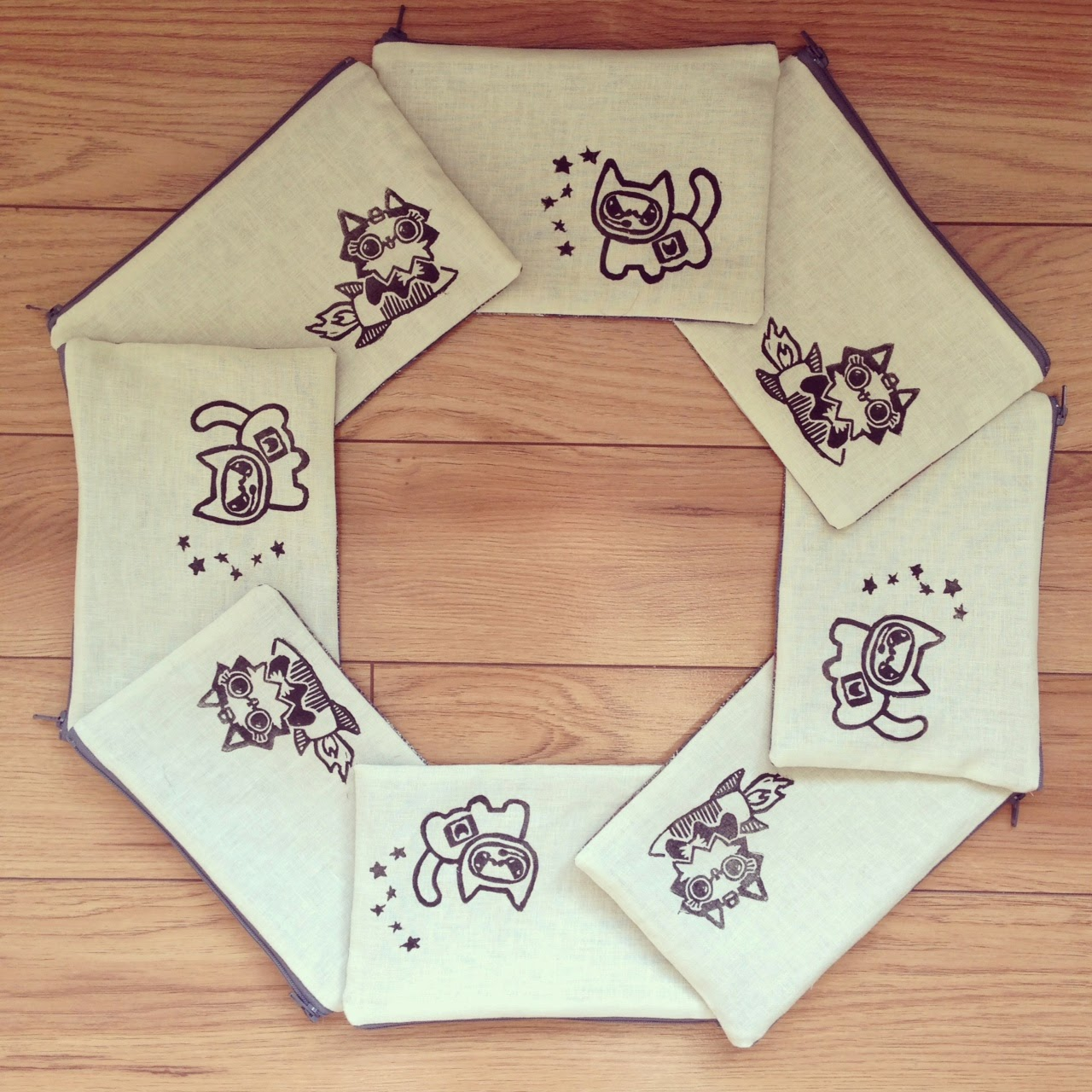 Cats in Space pouches arranged in the shape of a STOP sign.